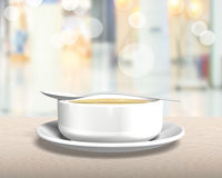 Soup bowl with tray and spoon Stock Image