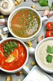 Soup bowls mashroom cream soup fish and tomato in bowl with crou Stock Photos