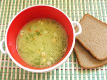 Soup and bread on bamboo napkin. Soup and bread on green bamboo napkin Stock Photo