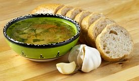 Soup, bread and garlic Royalty Free Stock Photo