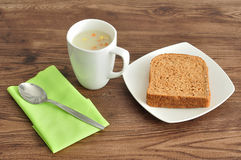 Soup, bread and a napkin Stock Image