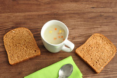 Soup, bread and a napkin Stock Photo