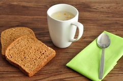 Soup, bread and a napkin Royalty Free Stock Photos