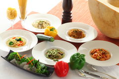 Soup, bread, salad, dessert with seafood and noodle pasta on whi Royalty Free Stock Image