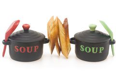 Soup break,  on white. Two  soup casselole with crouton in between,  on white background Stock Images