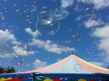 Soup bubbles over the circus tent. Soup bubbles with sky in the Background over the circus tent Stock Photo