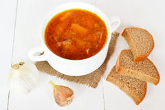 Soup with cabbage, potatoes, tomatoes, beets, meat. Pieces of bread, garlic Stock Images