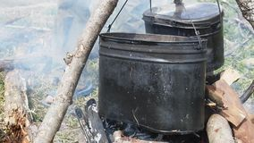 Soup on camping fire. stock footage