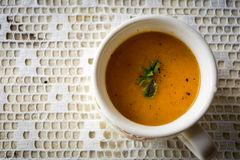 Soup with carrots, ginger and orange juice. Decorated with mint seen from above royalty free stock image