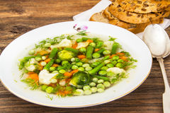 Soup with Cauliflower, Brussels Sprouts, Green Beans, Peas, Carr Stock Image