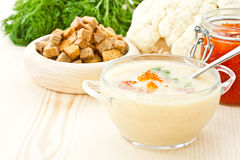 Soup cauliflower puree with red caviar Stock Image
