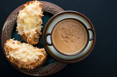 Soup and cheese melt bread. Chipotle sauerkraut with melted gouda cheese on rye bread accompanied by home made chestnut soup. Sauerkraut is known for its health Stock Image