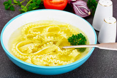 Soup with Chicken Broth with Noodles and Vegetables Royalty Free Stock Photos