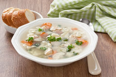 Soup with chicken, cauliflower, vegetable and bread in white pla Royalty Free Stock Photos
