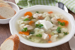 Soup with chicken, cauliflower, vegetable and bread in white plate Royalty Free Stock Images