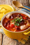 Soup of chicken with chili, beans, corn and tomatoes close-up in. A bowl on the table. vertical Stock Photos