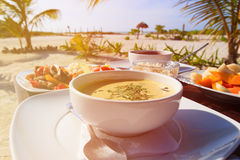 Soup,  chicken rice and fruit salad served on beach Royalty Free Stock Photos