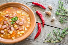 Soup with chickpeas and smoked sausage Stock Image