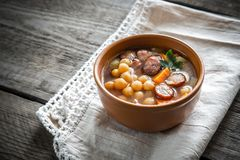 Soup with chickpeas and smoked sausage Royalty Free Stock Images