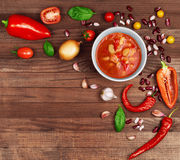 Soup Chili con carne on wooden background surrounded by vegetabl Royalty Free Stock Images