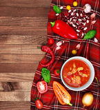 Soup Chili con carne on wooden background surrounded by vegetabl Stock Image
