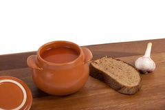 Soup in clay pot Stock Images