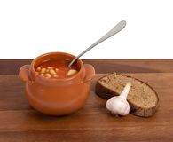 Soup in clay pot with bread and garlic Stock Images
