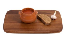 Soup in clay pot on wooden kitchen board Stock Photo
