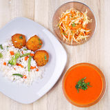 Soup, coleslaw salad and meat with rice Stock Image