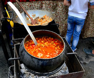 Soup cooked outdoors on hot coals in a cast iron pot. Ethnographic festival. Ukraine Royalty Free Stock Photos