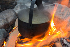 Soup cooked in a pot on the fire Stock Photos