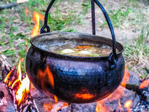 Kettle on the fire Royalty Free Stock Photography