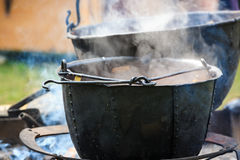 Soup cooking in medieval pot Royalty Free Stock Photo