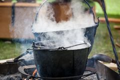 Soup cooking in medieval pot Stock Images