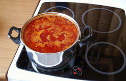 Soup cooks on an electric plate. Soup cooks on a plate Royalty Free Stock Photos
