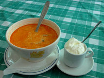 Soup and cream. A tripe soup and cream on a table in a restaurant Stock Photography