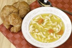 Soup and croisssant Stock Image