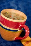 Soup Cup. Cup of steaming soup with serviette Stock Photo