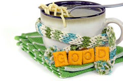 Soup cup with winter scarf and crackers Royalty Free Stock Photos