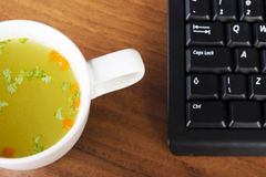 Soup cup at work. Stock Photos