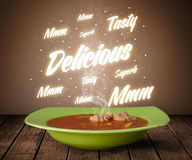 Soup with delicious and tasty glowing writings Stock Photography