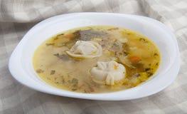 Soup with dumplings Stock Photo