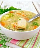 Soup fish with millet and spoon on white board Stock Image