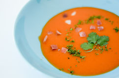 Soup. Food, tomato or gaspacho, on blue plate over white background Royalty Free Stock Photography