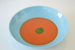 Soup. Food, tomato or gaspacho, on blue plate over white background Royalty Free Stock Photo