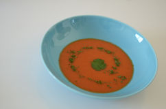 Soup. Food, tomato or gaspacho, on blue plate over white background Stock Image