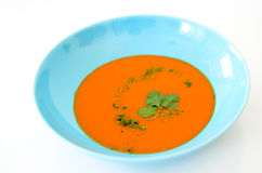 Soup. Food, tomato or gaspacho, on blue plate over white background Stock Photo