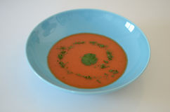 Soup. Food, tomato or gaspacho, on blue plate over white background Royalty Free Stock Images