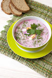 Soup with fresh beets served cold with  sour cream Stock Photos
