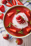 Soup of fresh strawberry with yogurt close up in a bowl. vertica Royalty Free Stock Image